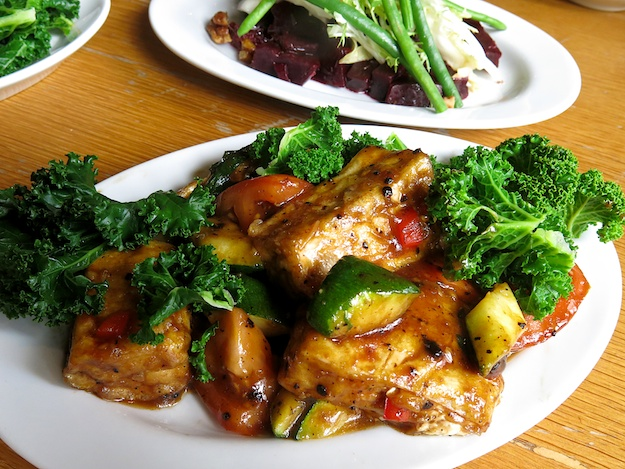 braised tofu in black bean sauce over Asian Kale