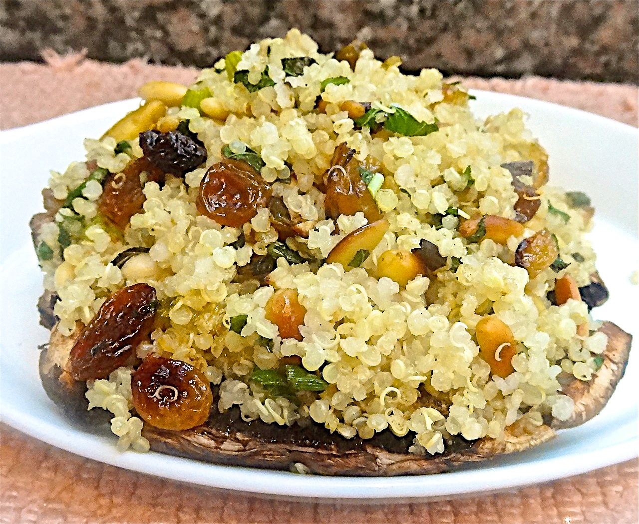 Quinoa Stuffed Portobello Mushrooms with Raisins and Pine Nuts