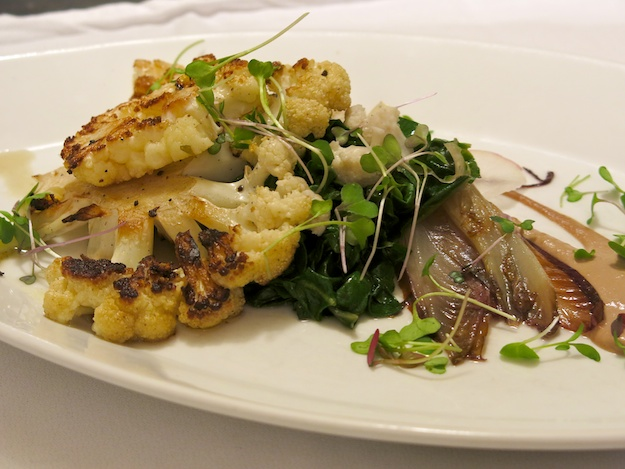 Cauliflower steaks over wilted greens, walnut milk and pickled cauliflower