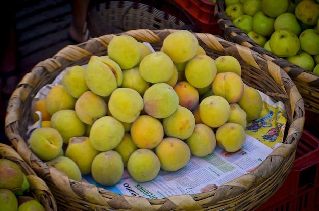 Katy shops peaches in Guatamala