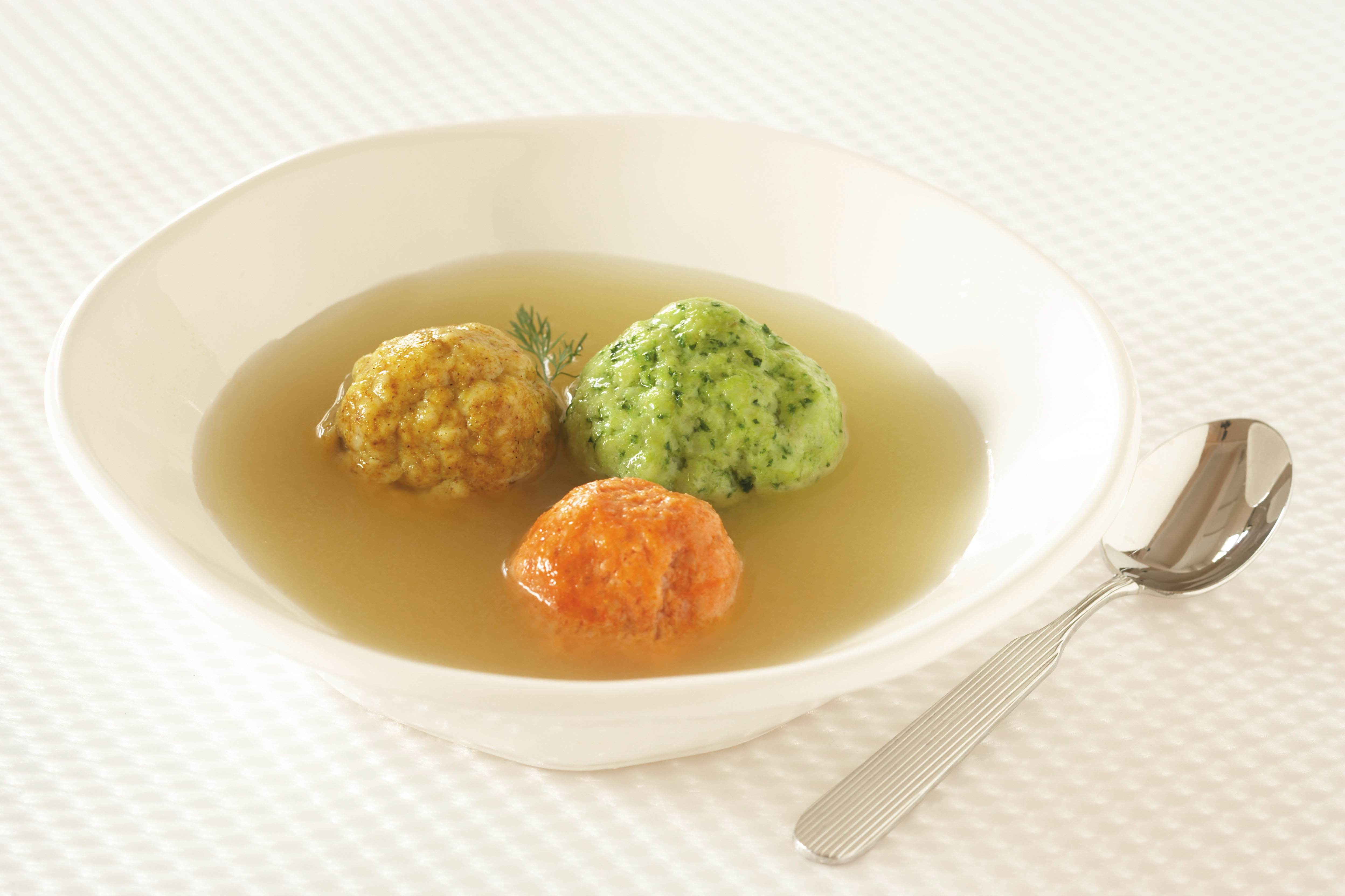 Chicken Soup with Colorful Matzah Balls