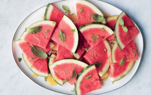 honey drizzled watermelon with herbs